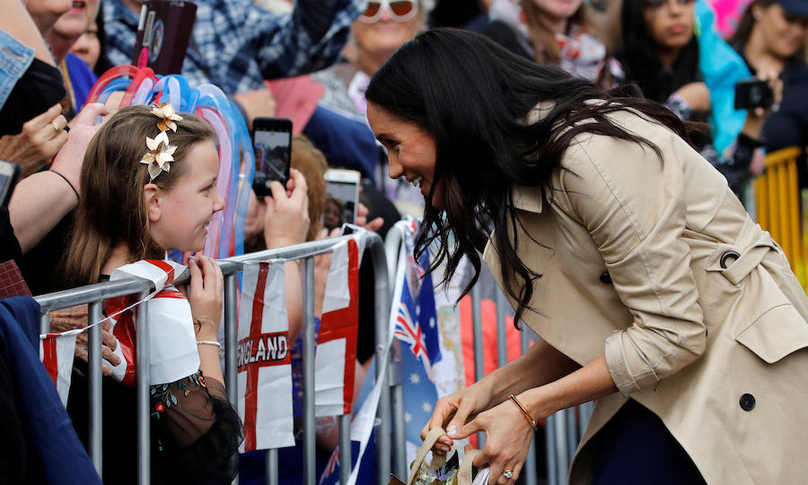 This little girl looked over the moon to be chatting with a royal as Meghan stopped to talk to her on Government House Drive in Melbourne, Australia! 