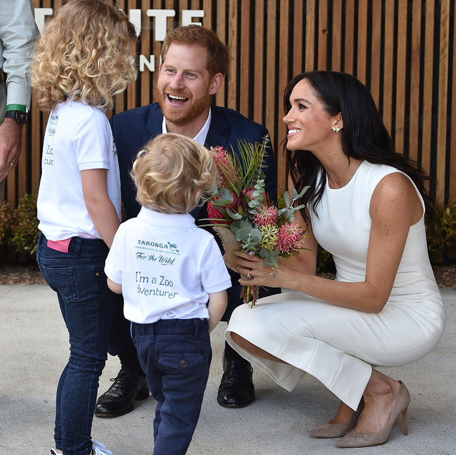 The expectant parents met an adorable pair of fans at Taronga Zoo in Sydney, Australia, who gave the duchess a bouquet. The Sussexes were beaming as they chatted with the youngsters, proving once again why they'll be the best parents!