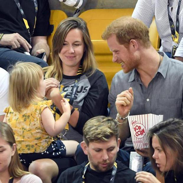 Prince Harry melted hearts after he was spotted sharing his popcorn with a little girl at the Invictus Games on in September 2017. The royal was sat next to Emily, the two-year-old daughter of Paralympian athlete David Henson, a former royal engineer who lost his legs to an IED in Afghanistan in 2011, and captained team UK at the first ever Invictus Games in 2014. And while David and his wife Hayley weren't looking, little Emily began to help herself to the prince's popcorn!
