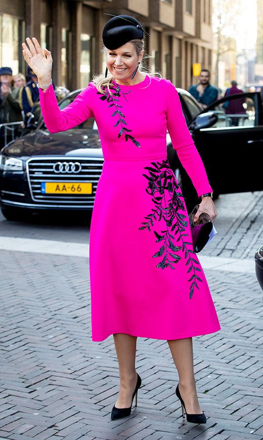 "On April 18, <a href=""https://ca.hellomagazine.com/tags/0/queen-maxima""><strong>Queen Máxima</a></strong> turned heads in a hot pink dress, adorned with glittering floral designs. The Dutch queen attended the jubilee congress of Nibud in Utrecht, accessorizing her outfit with black suede pumps, a black hat and matching clutch.