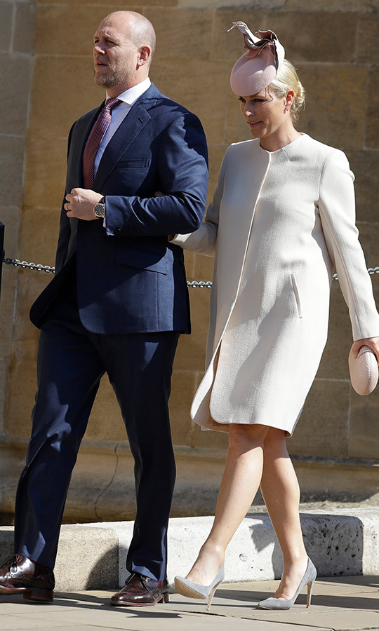Mike and Zara Tindall looked stylish as always, with Mike sporting a suit and Zara looking elegant in a white coat, gray heels and a fascinator. 