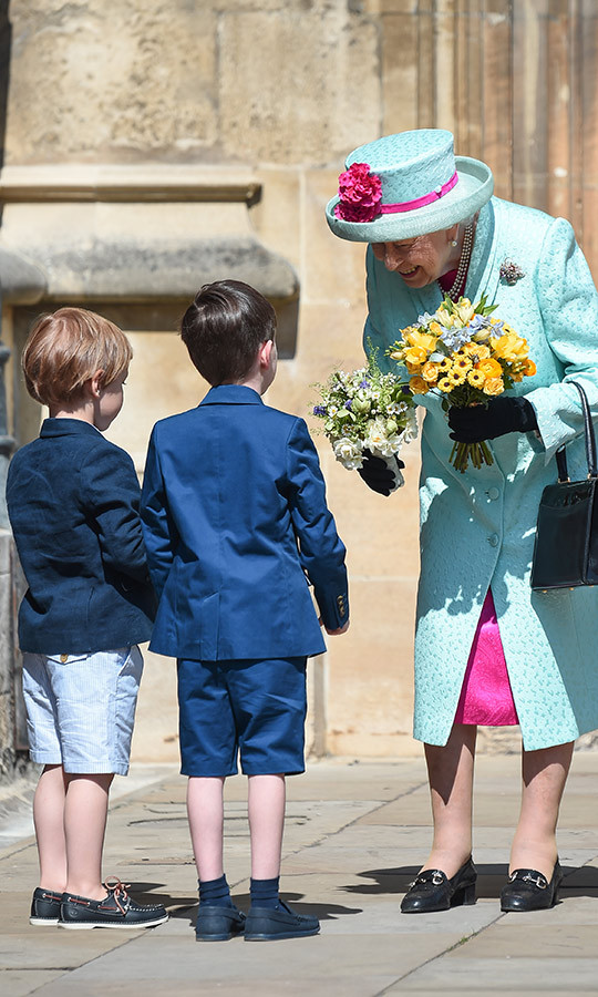 When she left the service, the Queen was given two bouquets by two very adorable little boys. Look at how happy she was to receive them! 