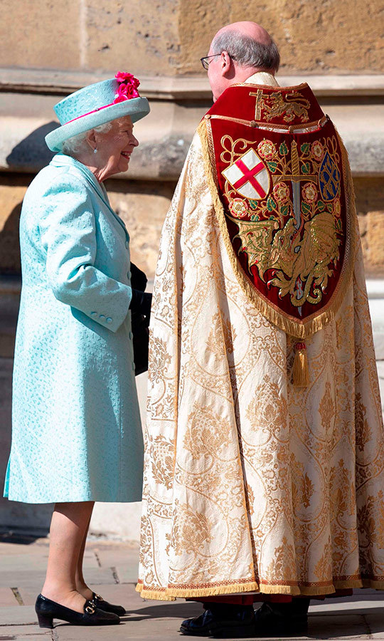 Her Majesty, who was turning 93 years old on Sunday, arrived wearing a beautiful light blue coat, pink dress and matching hat with pink trim. She very much looked dressed for the occasion! Here she is greeting David Conner, the Dean of Windsor, before the service.