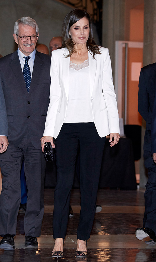 "<strong><a href=""https://ca.hellomagazine.com/tags/0/queen-letizia"">Queen Letizia</strong></a> wore a simple black-and-white outfit to attend the literature awards at Casa de Correos on April 25. She paired a white blazer and camisole with black pants and pumps.