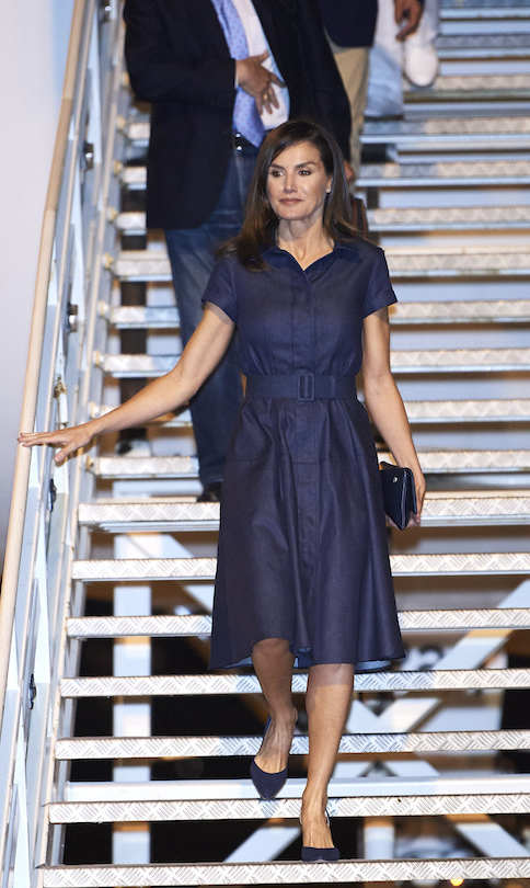 Letiziz wore a beautiful denim belted dress while arriving at the Maputo International Airport on April 28 in Mozambique. Queen Letizia of Spain is on a two-day visit to Mozambique to support the Spanish cooperation projects.