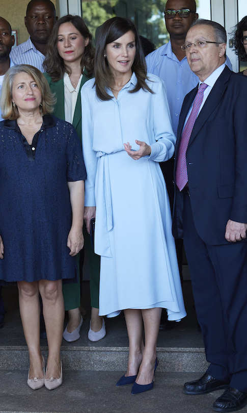 While visiting the Spanish Technical Office of Cooperation later that day, the mother-to-two stunned in a powder blue dress and navy blue pumps.