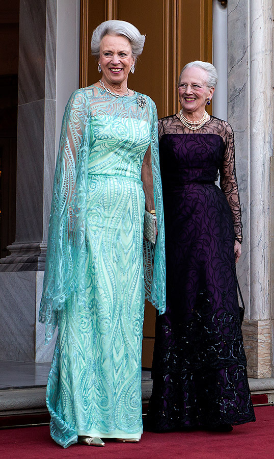 Queen Margrethe and her younger sister and birthday girl, Princess Benedikte, brought some glitter to the lavish affair! Margrethe dazzled in a turquoise caped gown, while Benedikte shined bright in strands of pearls and a deep purple dress.