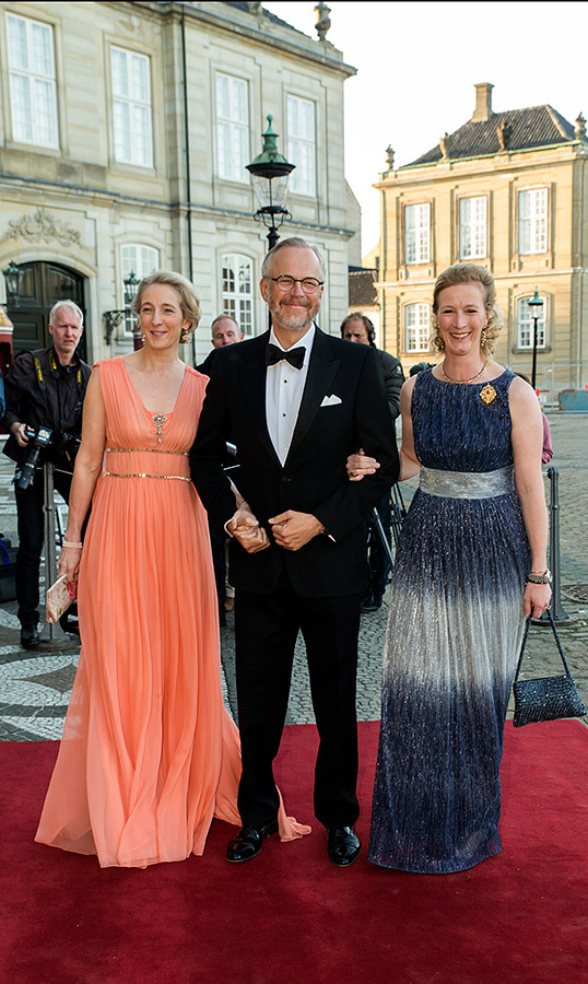 Princess Benedikte's two daughters, Princess Alexandra and Princess Nathalie, arrived at their mom's birthday celebrations. Alexandra stunned in a Grecian-inspired orange gown, while her sister chose a beautiful blue-and-silver dress for the occasion.