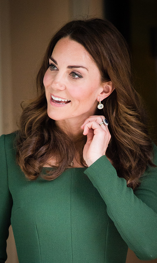 The duchess, of course, rocked her trademark bouncy curls and a pair of her favourite Kiki McDonough earrings, along with her stunning engagement ring. As for makeup, Kate kept things simple with a lined eye and a natural lip.