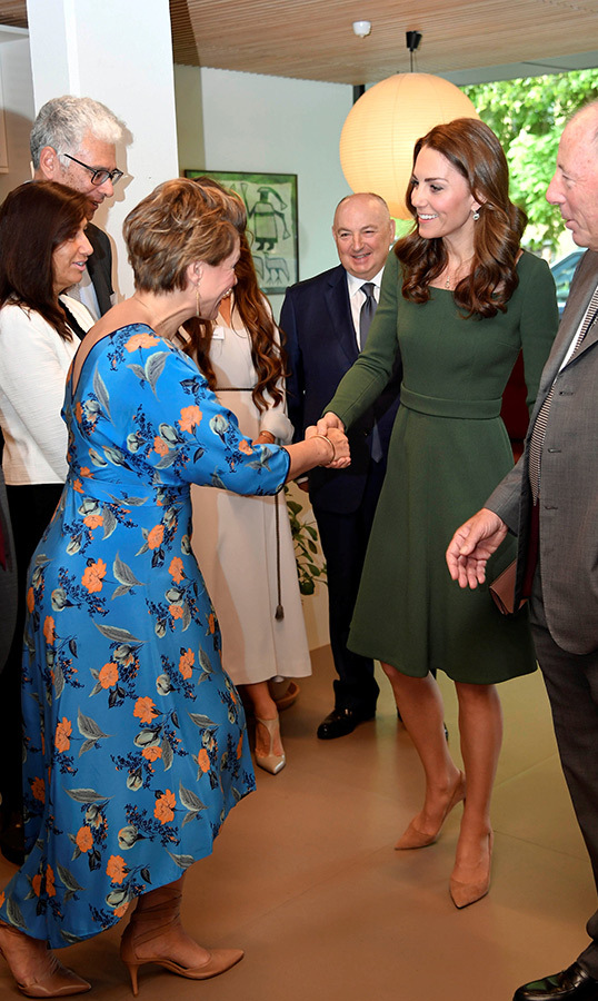 She shook hands with journalist <strong>Kate Silverton</strong>, who was beautifully dressed in a blue floral dress for the occasion.