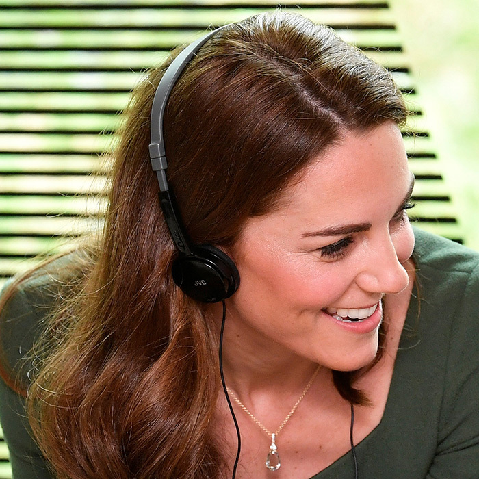 Kate smiled while listening to the program.