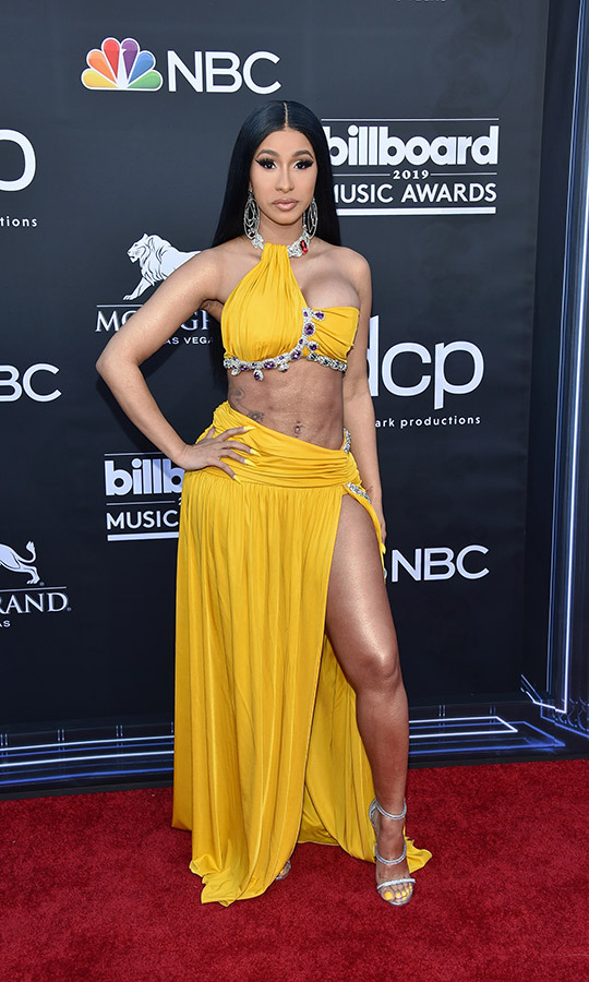 "<a href=""https://ca.hellomagazine.com/tags/0/cardi-b""><strong>Cardi B</strong></a> showed up wearing a yellow bikini, matching yellow skirt, and even had her fingernails and toenails painted yellow. 