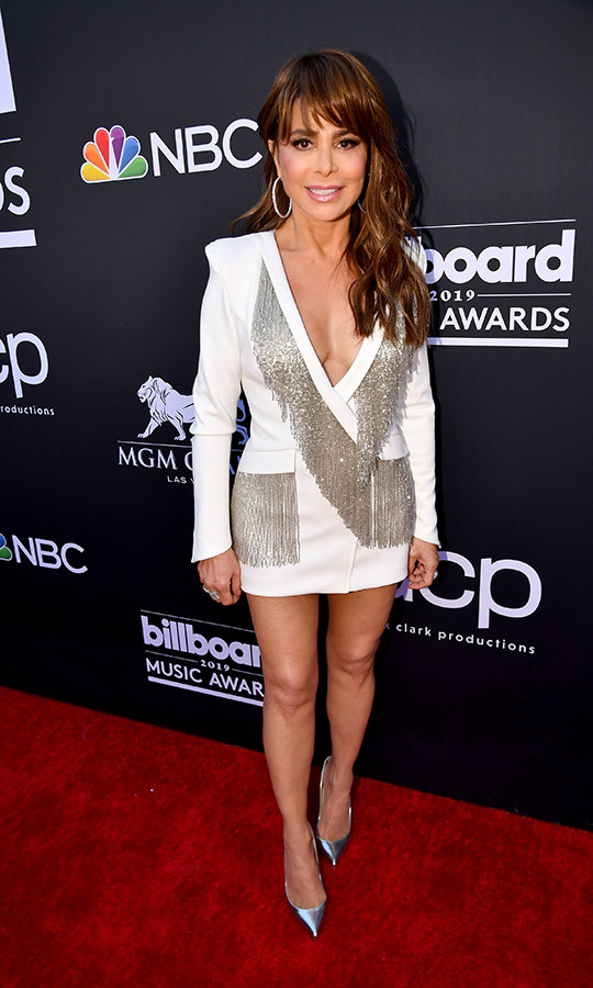 "Canada's own <strong><a href=""https://ca.hellomagazine.com/tags/0/paula-abdul"">Paula Abdul</a></strong> chose a timeless look that would have looked just as awesome in the '80s as it does today. Her white dress resembled a blazer and was adorned with multiple silver tassles. 