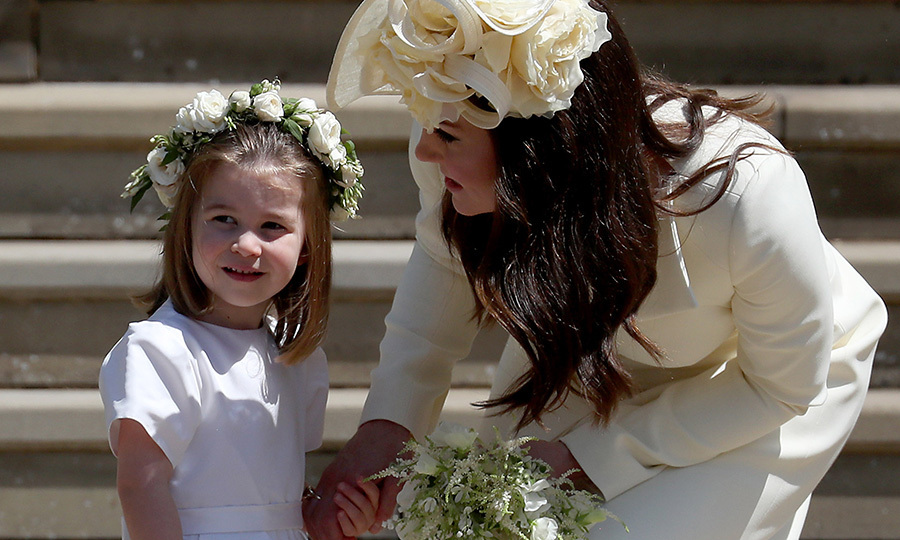 "Adorable Charlotte stole the show several times at the royal wedding of uncle <a href=""/tags/0/prince-harry""><strong>Prince Harry</a></strong> and aunt <a href=""/tags/0/meghan-markle""><strong>Duchess Meghan</a></strong> back in May 2018. Here's mom Kate having a quick talk with her daughter on the steps of St. George's Chapel before heading in to the ceremony. So sweet! 