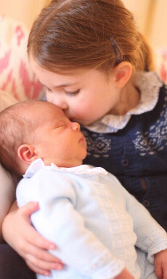 On Charlotte's third birthday, this adorable portrait - again taken by Kate! - was released, showing her planting a loving kiss on little brother Louis's forehead. Awww!