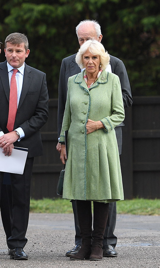 Camilla, Duchess of Cornwall was the picture of spring in a beautiful green coat dress, paired with knee-high brown suede boots for a visit to The National Stud on May 2.