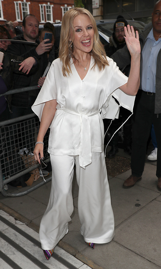 "<a href=""/tags/0/kylie-minogue""><strong>Kylie Minogue</a></strong> looked wonderful in white while arriving at BBC Radio 2 on May 3 in London. The icon graciously took time to sign autographs for fans.