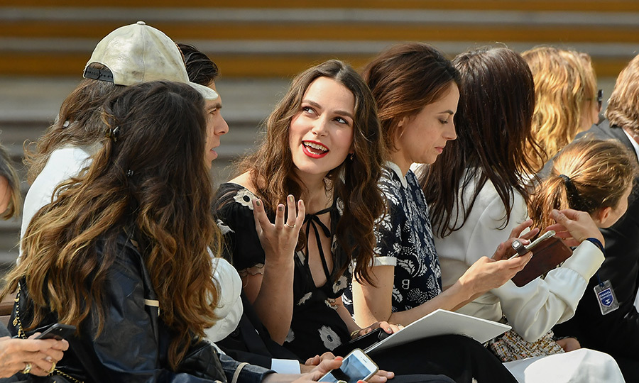 "The soon-to-be mom of two <a href=""/tags/0/keira-knightley""><strong>Keira Knightley</a></strong> had an animated conversation while sitting front row at the Chanel Cruise Collection 2020 show in Paris.