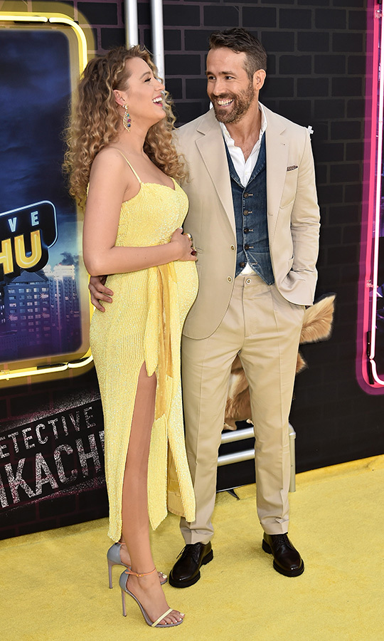 "Another baby bump for the books! <a href=""/tags/0/blake-lively""><strong>Blake Lively</a></strong> dazzled in yellow alongside her husband, <a href=""/tags/0/ryan-reynolds""><strong>Ryan Reynolds</a></strong>, at the premiere of <em>Pokémon: Detective Pikachu</em>.