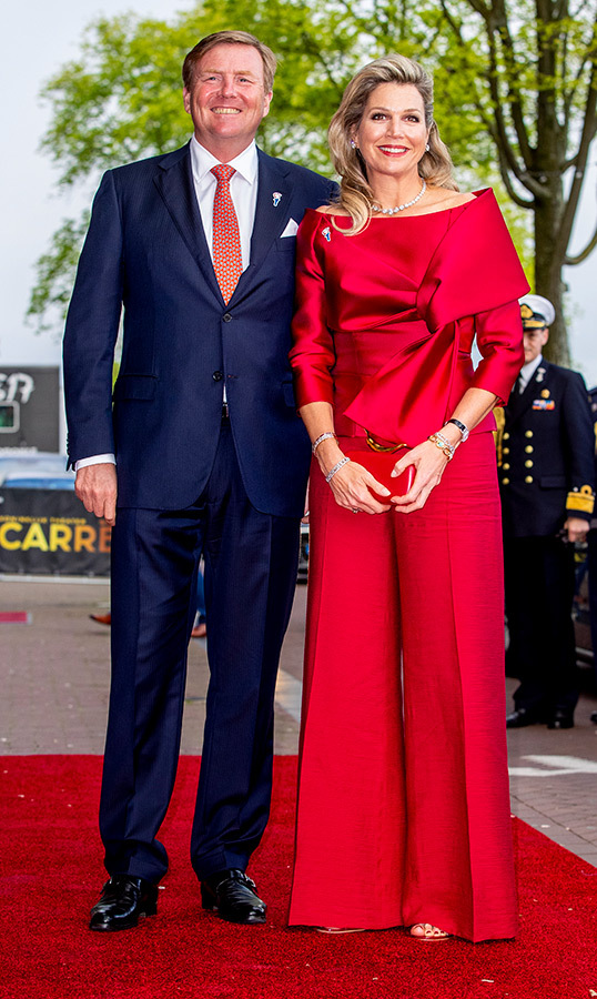 <strong>Queen Máxima</strong> was radiant in red at the liberation day concert on the Amstel River on May 4. The queen of monochrome dazzled in bright palazzo pants, paired with a matching satin top, red sandals, a small clutch and the chicest of hairstyles.