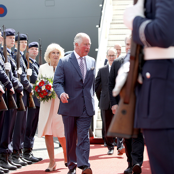 Prince Charles inspected the guard while Camilla held on to a beautiful bouquet of flowers. The couple were greeted by officials on the tarmac.