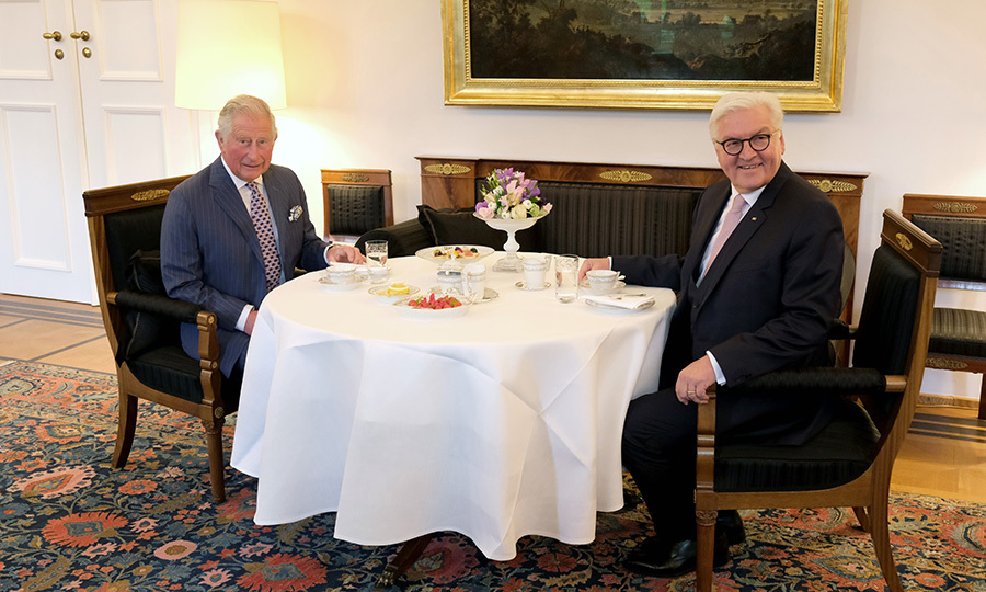 The two enjoyed a beverage together at a table inside the Palace.