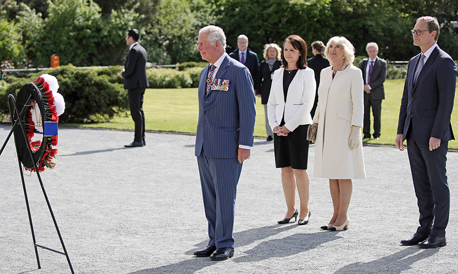 Alongside Claudia Mueller and Berlin Mayor Michael Mueller, Camilla watched her husband inspect a wreath at the memorial.