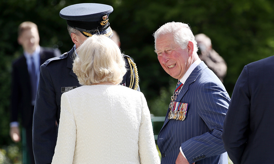 Charles showed off his winning personality while he and his wife greeted military personnel from Australia, France, Britain and Germany at the Airlift Memorial at Platz der Luftbrücke.