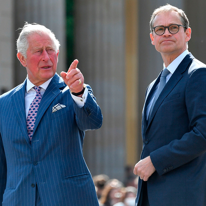 Charles pointed at something off in the distance.