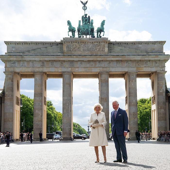 Charles and Camilla posed in front of the Brandenburg Gate during their visit.