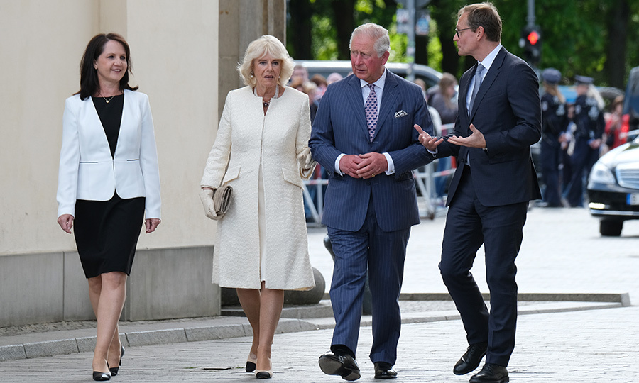 Prince Charles and Camilla walked with Berlin Mayor Michael Mueller and his wife <strong>Claudia</strong> at the Brandenburg Gate.