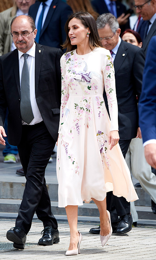 <strong>Queen Letizia</strong> of Spain wore a stunning pale pink floral dress to attend the commemorative act of The World Red Cross Day on May 7. She anchored the look with beige pumps.