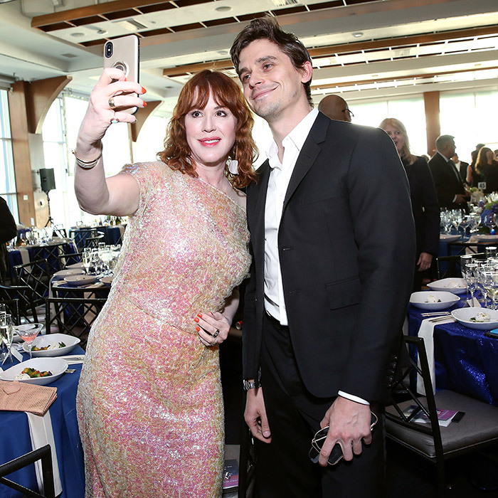 "<strong><a href=""/tags/0/molly-ringwald"">Molly Ringwald</a></strong> and <a href=""/tags/0/antoni-porowski"">Antoni Porowski</a></strong> stopped to take a selfie while attending the Family Equality Council's <em>Night At The Pier</em> Gala in New York City.