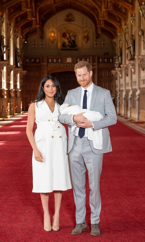 "<strong>Meghan</strong> looked no further than one of her favourite styles, a trench dress, for the momentous occasion of <strong><a href=""/tags/0/archie-harrison"">Archie Harrison</a></strong>'s debut at Windsor Castle. Dazzling in cream, one of her go-to colours, the Givenchy number featured a pretty collar, double-breasted buttoning up the front, pockets and a tie waist. She anchored the look with a pair of beige suede Manolo Blahnik pumps.