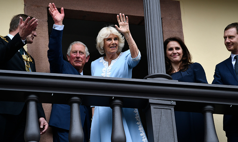 The duo waved from the balcony of the Rathaus (or Town Hall) in Leipzig.