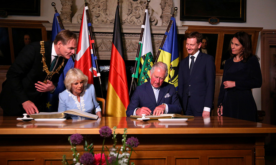Charles and Camilla joined Mayor of Leipzig <strong>Burkhard Jung </strong>(L), Saxony's Prime Minister <strong>Michael Kretschmer</strong> and his partner <strong>Annett Hofmann </strong>as they signed a book in city hall.