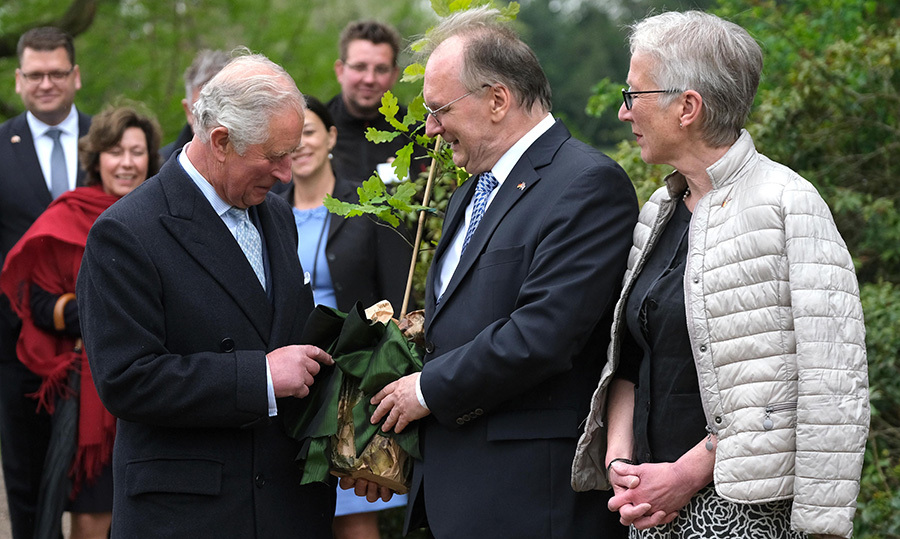 The Prince of Wales checked out the small tree he was about to plant.