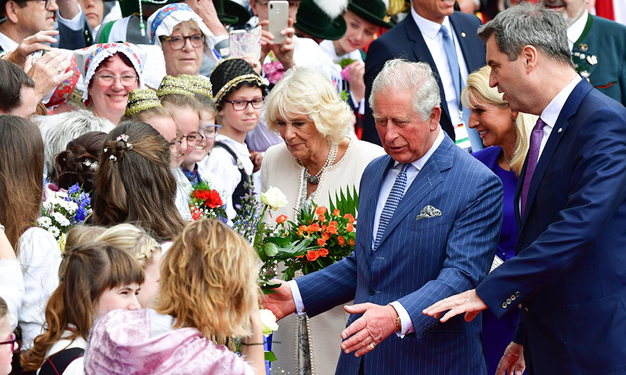 On day three, Charles and Camilla arrived in Munich, where they shook hands with young well-wishers in traditional Bavarian costumes.