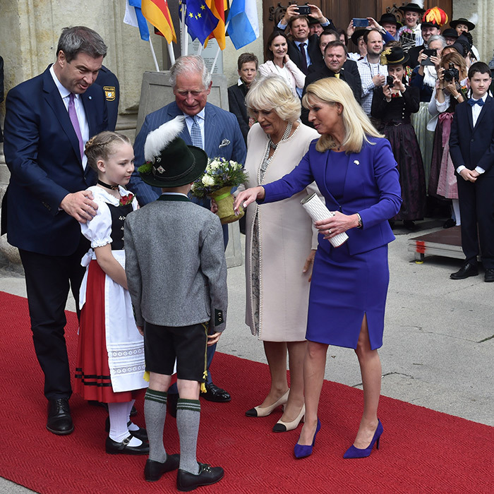 State Premier of Bavaria and leader of the conservative Christian Social Union party <strong>Markus Soeder</strong> and his wife, <strong>Karin Soeder</strong>, joined Charles and Camilla as they were greeted by children in front of the Munich Residence. The building is the former palace of the Wittelsbach monarchs, who ruled Bavaria from 1806 to 1918. 