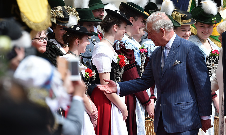 Charles reached out to shake one young woman's hand.
