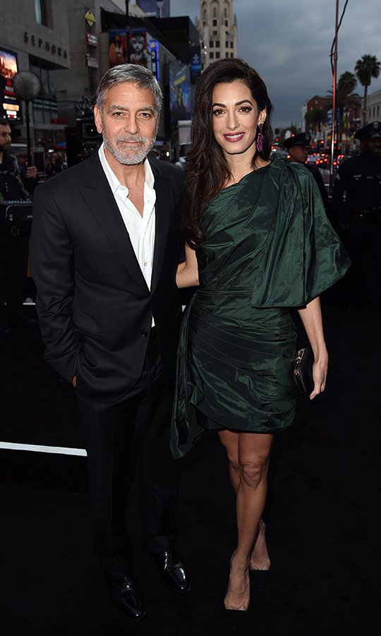 Two days before, George was joined by Amal at the premiere of <i>Catch 22</i>, a new Hulu miniseries he stars in that is based on the Joseph Heller book of the same name. Amal dazzled in a green shoulder dress, while George looked his usual dapper self in a suit.