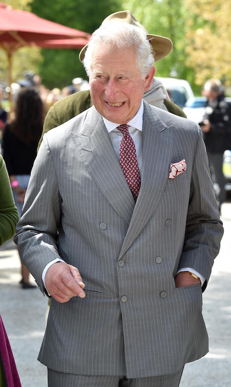 The prince showed off his personality, looking dapper in a grey pinstripe suit.