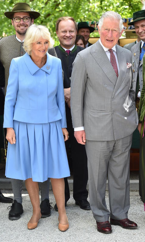 "Camilla and <a href=""/tags/0/prince-charles""><strong>Charles</a></strong> paid a visit to the organic farm Herrmannsdorfer Landwerkstaetten on May 10 in Glonn near Munich. For the affair, the Duchess of Cornwall looked beautiful in a blue coordinating skirt and blazer outfit.