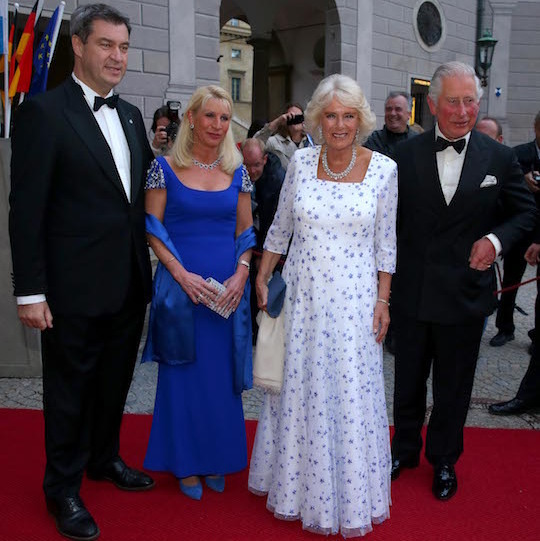 "<a href=""/tags/0/duchess-of-cornwall""><strong>Camilla</a></strong> dazzled in a blue-and-white gown for a State Dinner in Munich. She paired the number with a diamond necklace and small blue clutch.