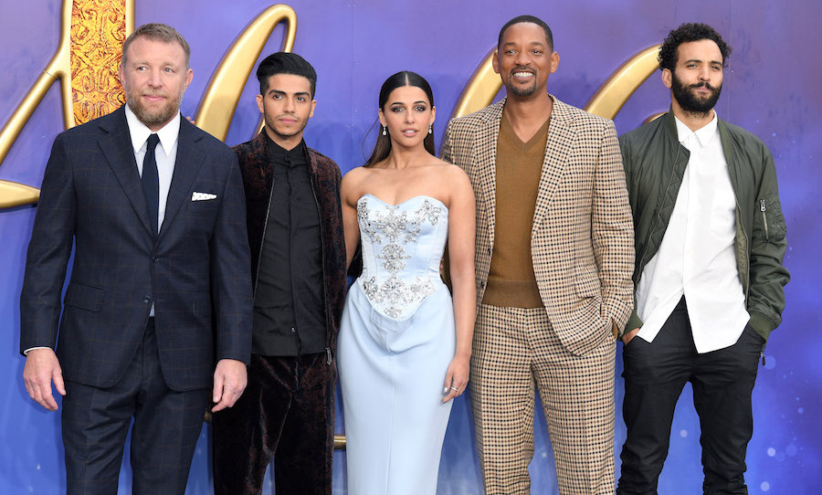 "Guy Ritchie, Mena Massoud, Naomi Scott, Will Smith and Marwan Kenzari posed for a glam shot at the <em>Aladdin""</em> European Gala at Odeon Luxe Leicester Square on May 9.