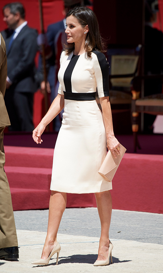 <strong>Queen Letizia</strong> stunned in a cream-and-white pencil dress for the 175th Anniversary of The Civil Guards on May 13. She paired the look with a small beige clutch and matching pumps.