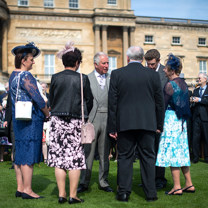 The 70-year-old prince generously took time to chat with some of the garden party goers, who were all perfectly dressed for the occasion – with fascinators to boot!