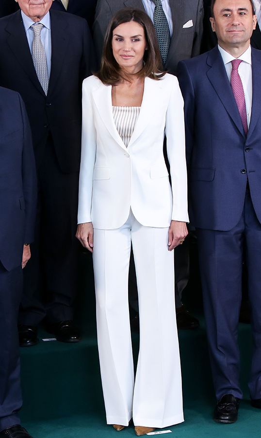 Queen Letizia of Spain looked wonderful in a white pantsuit for a visit to the Foundation Against Drug Addiction on May 16.