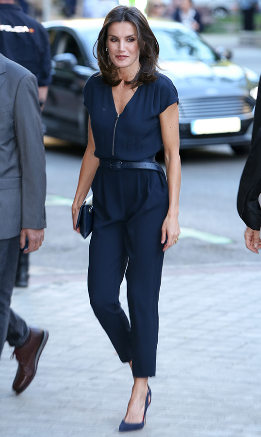 The Queen of Spain was the picture of elegance at a presentation in Gran Maestre Theatre on May 14. She stunned in a navy-blue blouse and cropped pant outfit, anchoring the look with blue pumps.