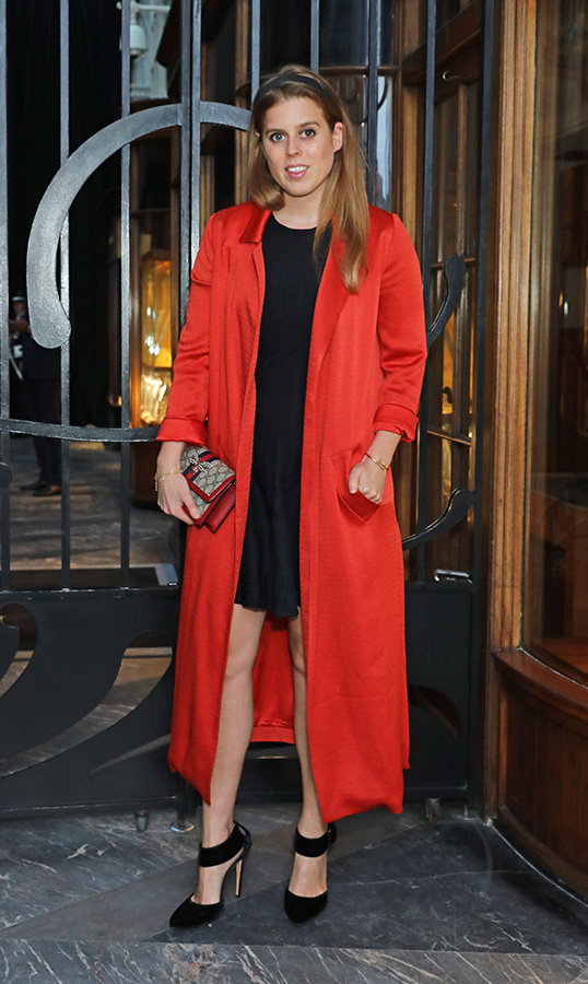 On May 8, <strong>Princess Beatrice</strong> of York attended the Burlington Arcade 200th anniversary dinner. She looked radiant in a red duster coat, black dress and black heels, accessorizing with a Gucci purse.